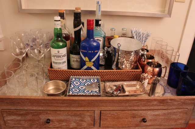 Grouping bottles together on a rattan tray helps keep the small space looking organized and neat